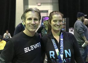 Elevate Fitness Run Club Coach Kevin Collins with Runner Cathy Sanders in Syracuse