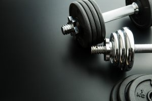 Lifting Weights at Elevate Fitness Gym in Syracuse, Dewitt, and Liverpool